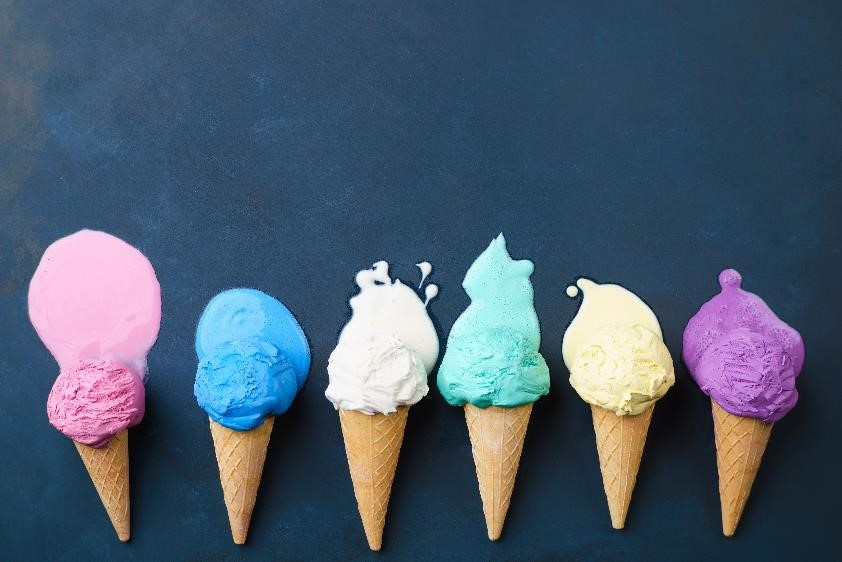 Different colored ice cream cones melting side by side.