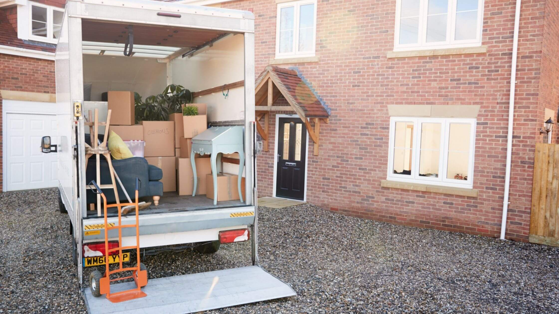 moving truck packed with items in front of an apartment building or home