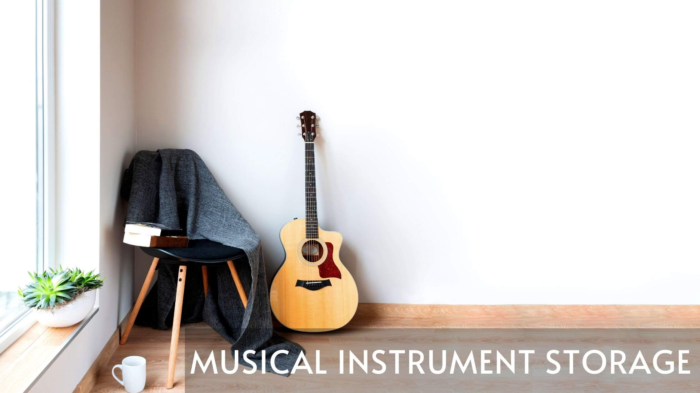 a guitar sitting in a white room next to a chair and a cup of coffee. Superimposed over the photo are the words musical instrument storage.